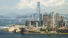 Hong Kong Victoria Harbor and Kowloon Panorama Cityscape - panning - stock footage
