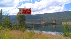 River and waterfall, Revelstoke dam wide shot Stock Footage
