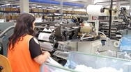 Stock Video Footage of Woman working in a factory of socks