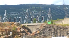 river and waterfall,Dam superstructure from electric substation, pan zoom reveal - stock footage