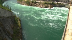 river and waterfall, Dam superstructure from river, pan reveal, #1 - stock footage