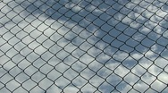 Stock Video Footage of Clouds through wire timelapse