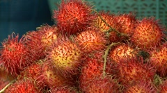 Tropical fruit rambutan close up Bali Stock Footage