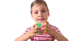 Girl holds interesting toy in both hands Stock Footage