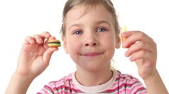 Girl holding a burger and represents how to eat them Stock Footage