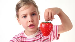 Girl holding timer in the form of strawberries Stock Footage