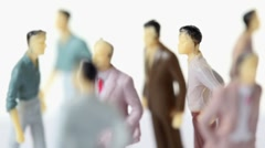 Upper body of several painted toy men is visible Stock Footage