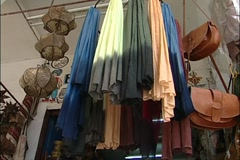 Rabat Clothing Store Cloth, purses and lanterns - stock footage