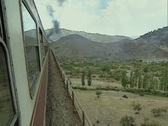 View from side of moving train over bridge Stock Footage