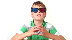 Boy sits in stereo glasses moves fingers and making faces Stock Footage