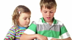 Two children plays with furry handcuffs Stock Footage