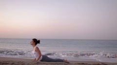 Yoga girl beach sunrise helathy lifestyle Stock Footage