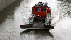Sewage treatment vessel sails down the river, the waves diverge in side Stock Footage