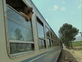 View up side of moving train with woman at window Stock Footage