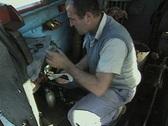 Worker inside steam train engine room Stock Footage
