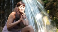 Stock Video Footage of young woman drinking a glass of mineral water
