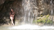 Stock Video Footage of woman under  waterfall at  resort
