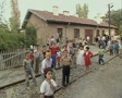 Little children standing at train station and waving at camera Footage