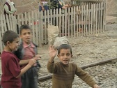 Children waving goodbye to moving train Stock Footage