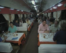 Interior of dining carriage with people sitting at tables Stock Footage