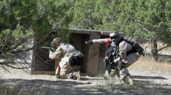 Paintball warriors behind barricade P HD 0106 Stock Footage