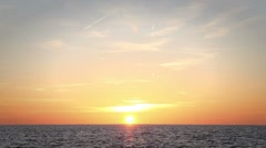 Sunset over water Stock Footage