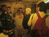 Tour group inside dark room Stock Footage