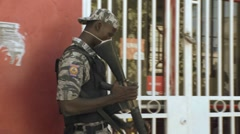 Armed military guards outside a secure area in Haiti. Stock Footage