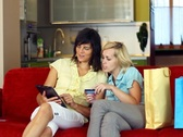 Two female friends make online purchase with credit card Stock Footage