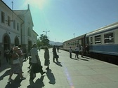 Train at platform with people boarding Stock Footage