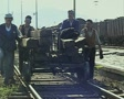 Men pushing lumber along train track SD Footage