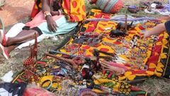 Ethnic Masai Woman Sells Curios on Colorful Blanket to Tourist Stock Footage