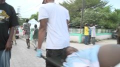 A victim is moved from a stretcher during the earthquake in haiti. Stock Footage
