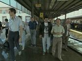 Men walking through train station Stock Footage