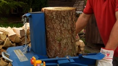 Man log splitting Stock Footage