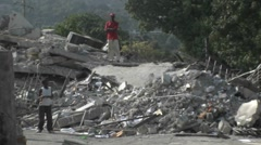 People sift through the rubble following the Haiti earthquake. - stock footage