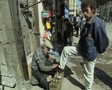 Shoe shiner on street Footage