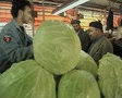 Cabbages stacked up at market stall Footage
