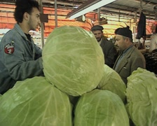 Stock Video Footage of Cabbages stacked up at market stall