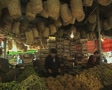 Baskets and vegetables at market stall Footage