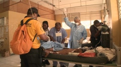 Doctors work in a trauma center following the Haiti earthquake. Stock Footage