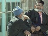Two old men chatting in street Stock Footage