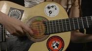Woman play guitar closeup Stock Footage