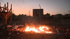 An open fire burns on the streets of Haiti following an earthquake. Stock Footage