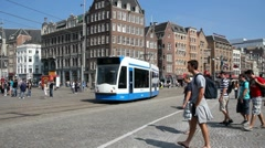 Trams and tourists in Amsterdam Stock Footage