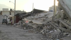Piles of rubble line the streets following the devastating Haiti earthquake. - stock footage