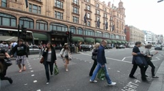 Pedestrians at Harrods in London - stock footage