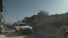 Rubble lines the streets following the earthquake in haiti. - stock footage