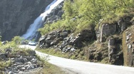 Stock Video Footage of A Ferrari driving past a waterfall