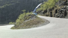 Cars cornering on a mountain road Stock Footage